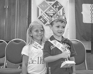 Royal couple honored: Wearing their crowns and holding trophies they received as they were crowned princess and prince at the 12th annual Our Lady of Mount Carmel Festival on July 22 at 343 Via Mount Carmel are, from left, Arianna DiFabio, 5, of Poland, and Anthony Mordocco, 4. of Canfield. The youngsters were among the 13 girls and 10 boys of Italian descent competing for the title this year. Last year Arianna's sister, Brianna DiFabio, was honored as the princess  at the festival.