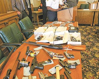 Youngstown and Warren offi cials announce the fi rst wave of federal indictments to come out of the Violence, Gun Reduction Interdiction Program. Officers have confiscated 41 guns and indicted four people since the coordinated local and federal offensive against crime in the Mahoning Valley began July 4.
