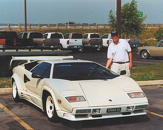 "Michael J. Lacivita of Youngstown calls this picture ""Wishful Thinking, Grandpa."" He's standing next to this Lamborghini at the Nelson Auto Group in Marysville, Ohio. He was vacationing with two grandsons, Jeffrey Vicarel and Patrick Krieger in June 2002."