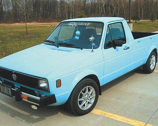 This 1980 VW Rabbit pickup belongs to Walter Smith of Campbell. It has its original 4-cylinder 1.7 motor with after-market S&S headers and dual exhaust. He purchased the truck in November 2006, and it came from South Carolina, but it was made in Westmoreland, PA. These trucks were built in 1980-83. It was restored mechanically by Scofield's of Warren, and the body and paint work were done by Montgomery's Auto Body in Struthers. He says this is a rare 30-year-old VW that runs like new.