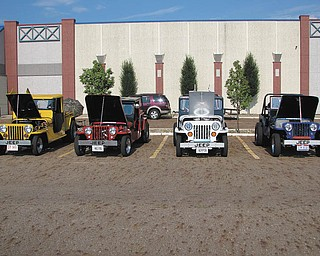 From left are: yellow 1953 CJ3B Jeep truck owned by Clarence Stevens of Poland; red 1948 CJ2A Jeep truck owned by Ron Stevens, Washingtonville; white 1953 CJ3B Jeep owned by John Stevens of Poland; and blue 1948 CJ2A Jeep owned by Don Stevens, New Middletown. The hand-built bodies and frames were a combined effort of Clarence, Don and John.