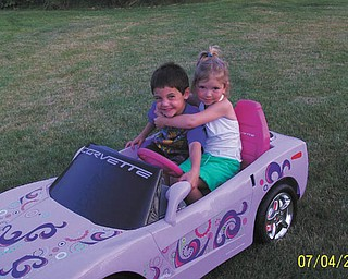 Car enthusiasts sure start young, don't they? This picture of Alivia Horvath, daughter of Rick and Kelley Horvath, and her friend, Haydon Pavlock, son of Arlene and Richard Pavlock, all from New Middletown, was sent by Alivia's great aunt, Marlene Koenig of New Middletown. She said although it's not a real sports car, she thought the picture was too precious to not send. We agree.