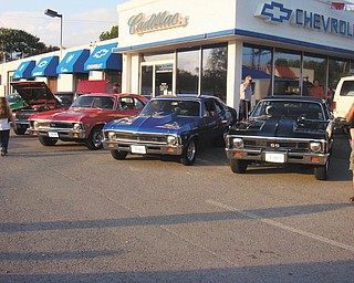 The red 1972 Chevy Nova belonging to Don E. Ardale of Boardman and blue 1968 Chevy Nova belonging to Ralph C. Ford of Canfield are pictured at the Chevy dealership in Salem..