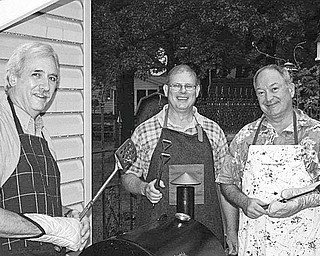 "What's cookin' in Canfield? Preparing ""Meal Deals"" that will be served to the public during the upcoming Car Trunk Sale at the Ursuline Center are, from left, Dan Eicher, Mark Curtis and Ray Novotny. The sale will take place from 9 a.m. to 2 p.m. Aug. 14 at the center, 4280 Shields Road, Canfield. Shoppers will find a large selection of bargains being offered by more than 50 people who will sell items from their homes out of the backs of their vehicles. In addition, plants, books and furniture will be for sale in the center auditorium. Proceeds will support Ursuline Center Ministries."