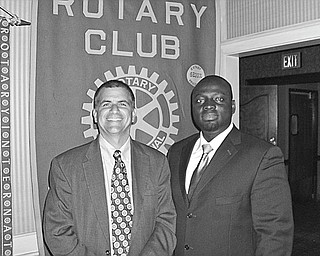 Lives reconstructed: After traveling to Ghana with five surgical nurse volunteers to perform reconstructive surgeries and to teach local doctors the procedures, Dr. Michael K. Obeng, at right, a plastic surgeon at St. Elizabeth Boardman Health Center, spoke of his experiences during a meeting of Youngstown Rotary Club. Obeng, also the founder and CEO of R.E.S.T.O.R.E. Worldwide Inc., told how the reconstructive procedures helped the poor with congenital or accidental deformities, who were shunned by families and the public, to become contributing citizens of Ghana. Obeng holds academic appointments at several institutions, including NEOCOM at Rootstown and the University of Pittsburgh. Sharing a moment with the speaker is Steve Kristen, Rotary Club president.