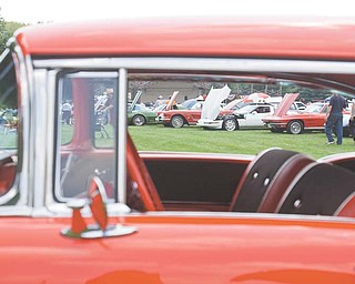 LISA-ANN ISHIHARA | THE VINDICATOR..Cars pack into Boardman Park for the Mahoning Valley Olde Car Club car show. John Sylvester of Boardman brought his 1957 Bel Air, front.