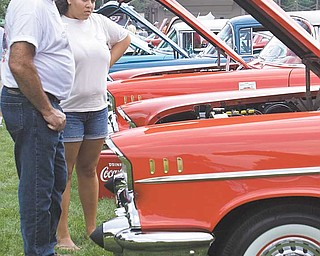 George Powell and his daughter, Tori, of East Palestine check out a Bel Air at the Mahoning Valley Olde Car Club Inc. show. George owns a 1937 Rio half-ton pickup street rod and recently purchased a 1923 Ford Model T.