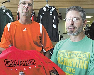 Jeff Kay, left, general manager of Knightline Embroidery and Screen Print, 16 W. Liberty St. in Girard, is president of the Girard Chamber of Commerce, and Patrick Rubinic is Knightline owner and chamber secretary. Kay and Rubinic keep the chamber going as a social organization.
