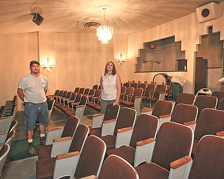 RThe Salem Community Theatre got a grant to fix its leaking roof, but other repairs were done for free by some area companies. Gary Eichler, left, of Eichler Construction of Salem was paid to fix the roof but did plastering and other work for free. At right is theater manager Sara Durham.