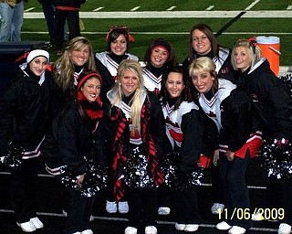 Canfield Varsity cheerleaders pose before their 1st playoff win against Aurora!!!