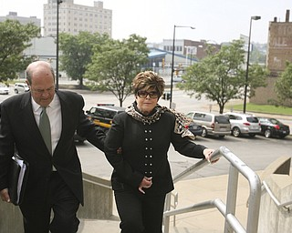 ROBERT K. YOSAY | THE VINDICATOR...ROBERT K. YOSAY | THE VINDICATOR ..Flora Cafaro  with her attorney  William Doyle  walks up the stairs to the Mahoning County Justice Center to be booked after being indicted by a grand Jury - he was joined by   Michael Sciortino, John McNally IV and ,Marty Yavorcik .-30-...-30-