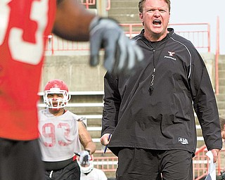 Youngstown State football coach Eric Wolford gets his point across during a spring practice at Stambaugh Stadium. Wolford has brought in 36 new players to the program since taking over.