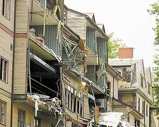 ROBERT K. YOSAY | THE VINDICATOR..The WIck Pollock Inn - as Demolition of the rooms  begins.-30-
