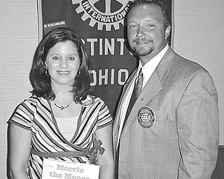 Know your coverage: The importance of reading the fine print on insurance policies was stressed by Mark Cole of the American National Insurance Co. when he spoke at the Aug. 2 meeting of the Rotary Club of Austintown. Cole suggested that policy owners upgrade their insurance in this day of lawsuits. After his talk Deanna Spirko presented him with a book for the Ohio Reads Project at Woodside Elementary Library.