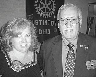 "Making the rounds: At its Aug. 9 meeting the Rotary Club of Austintown welcomed, at right, District 6650 Governor Jim Russell of Newcomerstown, who is attempting to fulfill his obligation to visit the 48 clubs in the district during his tenure. He has 19 more clubs to visit. Russell told how he became involved in Rotary and presented a video, ""Engaging With Rotary,"" that showed how each member moves within the 33,000 clubs worldwide. He asked members to work on meaningful projects, to build memberships, to support the Rotary Foundation and to support the worldwide distribution of lit kits. When she joined Russell after his talk, Susan Leetch, club president, presented the speaker with a gift and a book to be donated in his name to Woodside Library."