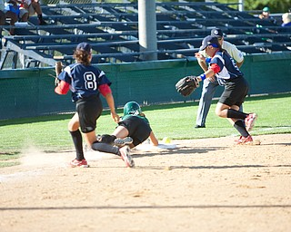 Jenna Schettler dives back to third safely after attempting to steal home during the 2010 World Series of Little League Softball, Central vs. Latin America. Central went on to win the game, 7-4.