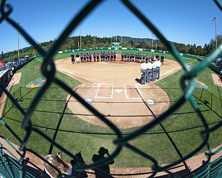 Teams line up for the National Anthem before the 2010 World Series of Little League Softball in Portland, Ore., August 15th, 2010. This game the team from Poland, Ohio face the team from Burbank Calif., Central was defeated by West, 0-1.