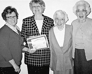 As one of her official duties as president of Austintown Historical Society, Joyce Pogany, second from left, presented life member certificates to , from left, Barb Dellesky, Marge DeHoff and Idabelle DeHoff at a recent past presidents dinner.
