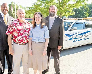 Chaplains, from left, Brian Dean of Kingdom Nation Church, Jay Eastman of Canfield Christian, Rebecca Richie of Lord of Life Lutheran and Larry Bowald of Canfield Presbyterian line up for a portrait outside the Canfi eld Police Department.