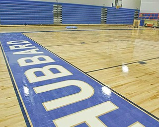 The gym at the new high school features maple hardwood flooring and stadium seating for 1,800 people. The gym can be converted into three separate areas with electric curtains.
