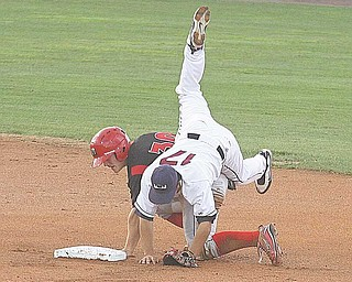 Kevin Fontanez (17) of the Scrappers gets upended by Christopher Edmonson of the Batavia Muckdogs during Wednesday's game at Eastwood Field in Niles. The Scrappers won 4-2.