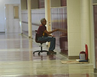 ROBERT K. YOSAY | THE VINDICATOR..Everett Lehman  checks each lockers combination at South Range finally finished itÕs new K-12 building. Superintendent Dennis J. Dunham will show us around the new building....-30-..