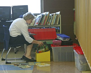 ROBERT K. YOSAY | THE VINDICATOR..Carole Hoff puts away books for her Third Graders  atSouth Range finally finished itÕs new K-12 building. Superintendent Dennis J. Dunham will show us around the new building....-30-..