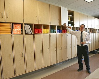 ROBERT K. YOSAY | THE VINDICATOR..Dr Dennis Dunham shows off some of the many storage areas in the elementary area at South Range finally finished itÕs new K-12 building. Superintendent Dennis J. Dunham will show us around the new building....-30-..