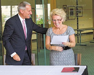 Ohio Board of Regents Chancellor Eric D. Fingerhut, pictured with YSU President Cynthia E. Anderson, gives approval Thursday to a doctorate program in materials science and engineering.