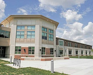 A distinctive architectural shape highlights the front of the new junior/senior high school, 1244 Shannon Road.
