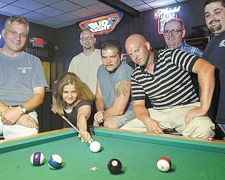 Members of the Rally Monkeys pool team will be heading to Las Vegas to compete in a 8 ball tournament. Lining up a shot is Linda Brickley. Looking on and giving advice are other members from left: John Samulka, Robert Hamilton, George Hamilton Jr., Charlie Brown Jr. Jim Wagner and John Ferraton.