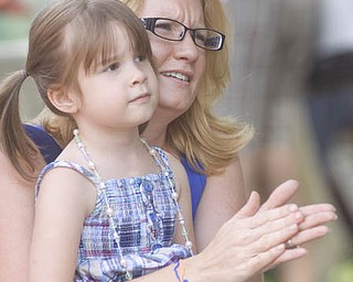 "LISA-ANN ISHIHARA | THE VINDICATOR..Audra Carlson of Liberty claps while holding her daughter Magdelene (ok), 4, as they watch ""The Pickled Brothers"" perform at the Northside Farmers Market"