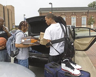 LISA-ANN ISHIHARA | THE VINDICATOR..YSU freshman Cordell Miller, 17, far right, of Mt. Vernon, NY gets help unloading from his mother Felicia Miller, of Mt. Vernon, NY, and his older brother DJ Baker of Brooklyn, NY.
