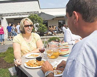 Lisa Grafton of Hinckley and Gary Posage of Salem enjoy refreshments Sunday at the Mastropietro Winery in Berlin Center. The winery was celebrating its fifth anniversary.