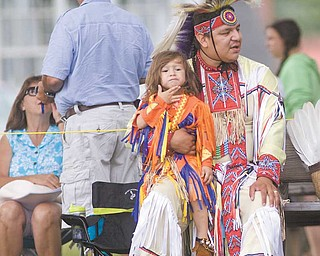 Blaine Tallchief of Salamanca, N.Y., holds Delsin Tallchief, 2, after performing at the Red Hawk Pow Wow at the Trumbull County Fairgrounds on Sunday.