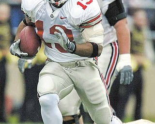 In this Nov. 8, 2002 file photo, Ohio State running back Maurice Clarett runs against Purdue in West Lafayette, Ind. Clarett is asking a judge to allow him to travel to try out with  the Omaha Nighthawks football team of the United Football League Clarett pleaded guilty in 2006 to aggravated robbery and carrying a concealed weapon and served 3½ years in a Toledo prison. He is attending classes at Ohio State while living in a detention facility in Columbus.