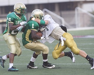 LISA-ANN ISHIHARA | THE VINDICATOR...Ursuline Trevor Smith #1 with Akise Teague #26, right behind him, as a Canton GlenOak Eagle blocks him during scrimmage game