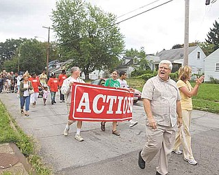 YoungstownÕs 7th Ward Councilman John Swierz joins members of The Alliance for Congregational Transformation Influencing Our Neighborhoods (ACTION) in a ÒMarch Against Crime and BlightÓ on YoungstownÕs South Side, they approach Gibson St as they walk west on Cameron Ave.