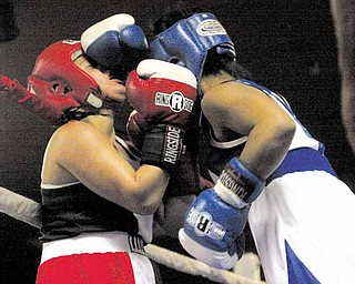 BOXING - Jasmen Guerro (red) gets a face full of Shanatia Evans during their bout Wednesday night. - Special to The Vindicator/Nick Mays