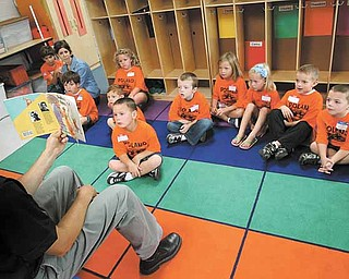 Michael Masucci, principal at Poland North Elementary School, reads a story to a group of incoming kindergartners during the annual Safety Village at the school, which teaches the youngsters various safety tips.