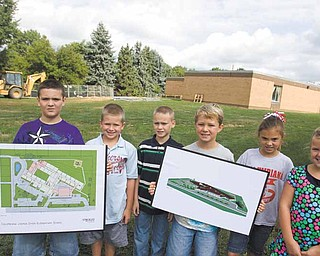 Third-graders at Joshua Dixon Elementary School in Columbiana display artist renderings of the addition that will be made to the school. From left are Steven Anderson, 8; Eli Strohecker, 8; Mark Siedor, 9; Jack Carney, 8; McKenzie Brooks, 8; and Julia Hum, 9.