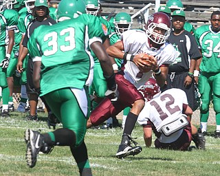 BOARDMAN - (1) Dyane Hammond looks for running room as (33) Rico Thompson tries to make the stop during their game Saturday afternoon. - Special to The Vindicator/ Nick Mays
