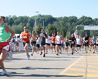 LESLIE CUSANO | THE VINDICATOR.Participants in the Panerathon 10K & 2 mile fun walk/run take off from the starting line Sunday. All money raised from the event will help build the Joanie Abdu Comprehensive Breast Care Center.