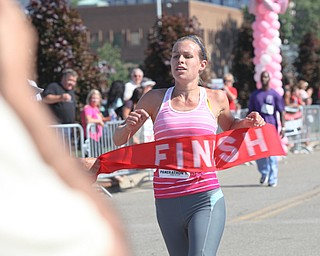LESLIE CUSANO | THE VINDICATOR.Christina Adams crosses the finish line of the 10K portion of the Panerathon today at the Covelli Center in Downtown Youngstown. Adams was the first female to cross the finish line.