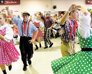 Geoffrey Hauschild|The Vindicator.Members of Piast Artistic Folk and Dance Ensemble, from Cleveland, Paulina Kossakowski, Aleks Wielgus, Barbara Sychla, Ryan Pluhar, Jacob Kossakowski, and Haley Pluhar, dance during Polish Day at St. Anne Church in Austintown on Sunday afternoon.