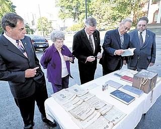 Mason l to r Russ Gillam Jr., Elberta Sctt, William Bell, Robert Rodkey and David Beaver look at items from the recently opened 19109corner stone box as they get set to celebrater the 100 year of the Youngstown location. Photo/Mark Stahl