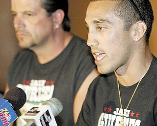 William D Lewis The vindicator  Jake the Bull Giuriceo, right, and trainer Keith Burnside  during a 9-1 news conference at Los Gallos in Boardman.