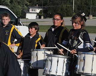 Pictured are just a few of the Lowellville Drumline members who entertained the crowds before the lowellville/ YCS game on Friday. - KELLY TKACH