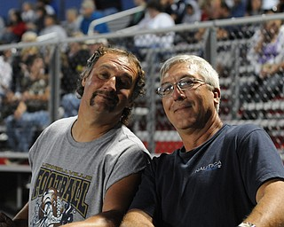 Ed Tkach and Brian Filip of Lowellville watch their sons play during the Lowellville/ Youngstown Christian game Friday. - KELLY TKACH