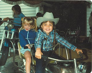 This picture of Toni (Shields) Acevedo of Boardman and Stephanie Gibson of Columbus enjoying the kiddie ride was taken in 1981.